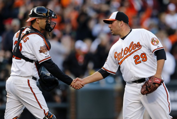 Matt Wieters congratulates Tommy Hunter after sealing a 2-1 Orioles win on Opening Day (Photo Courtesy of Patrick Semansky/Associated Press)