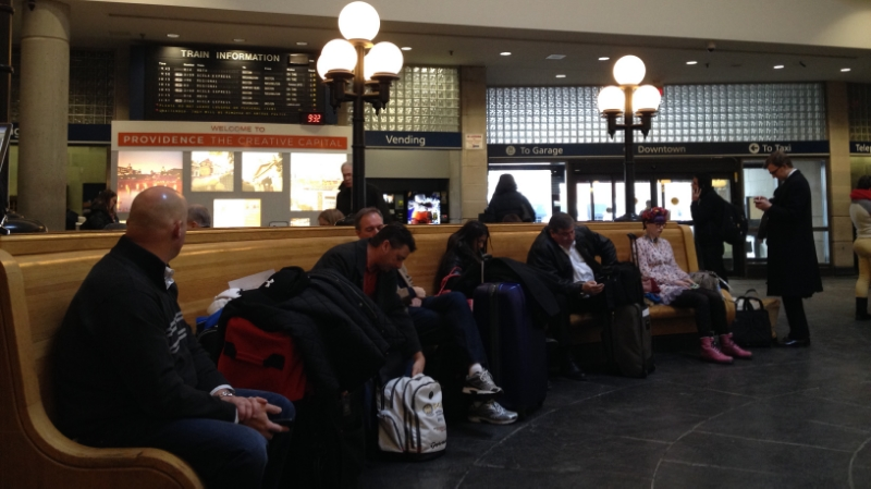 Commuters and travelers wait for their train in Providence