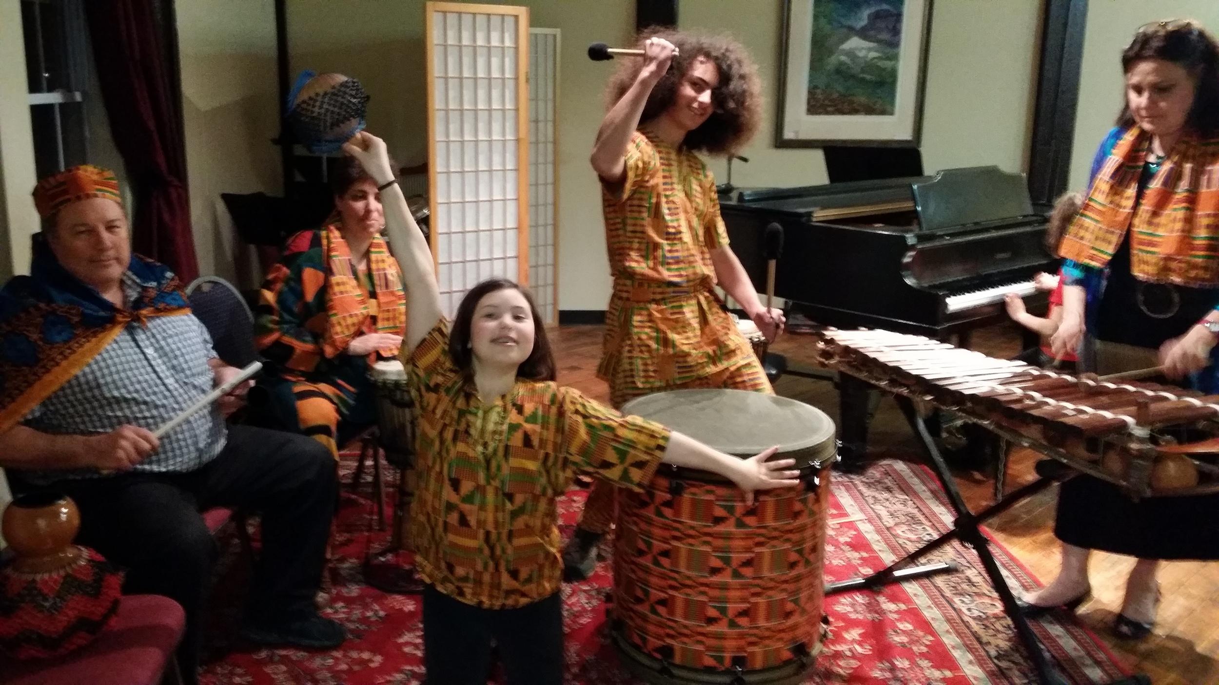 The Mumbo Jumbo drum group performs