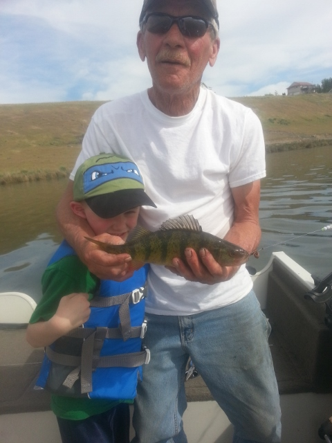 Tim's dad and Tim's son with a fat perch from Moses Lake.