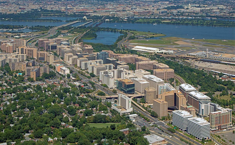 Aerial photo of north Arlington, VA. Washington DC is across the river to the north. Reagan National Airport is to the right. The strip of tall office buildings in the middle is Crystal City. To the upper left is Pentagon City, the Pentagon is just outside of the photo to the northwest.