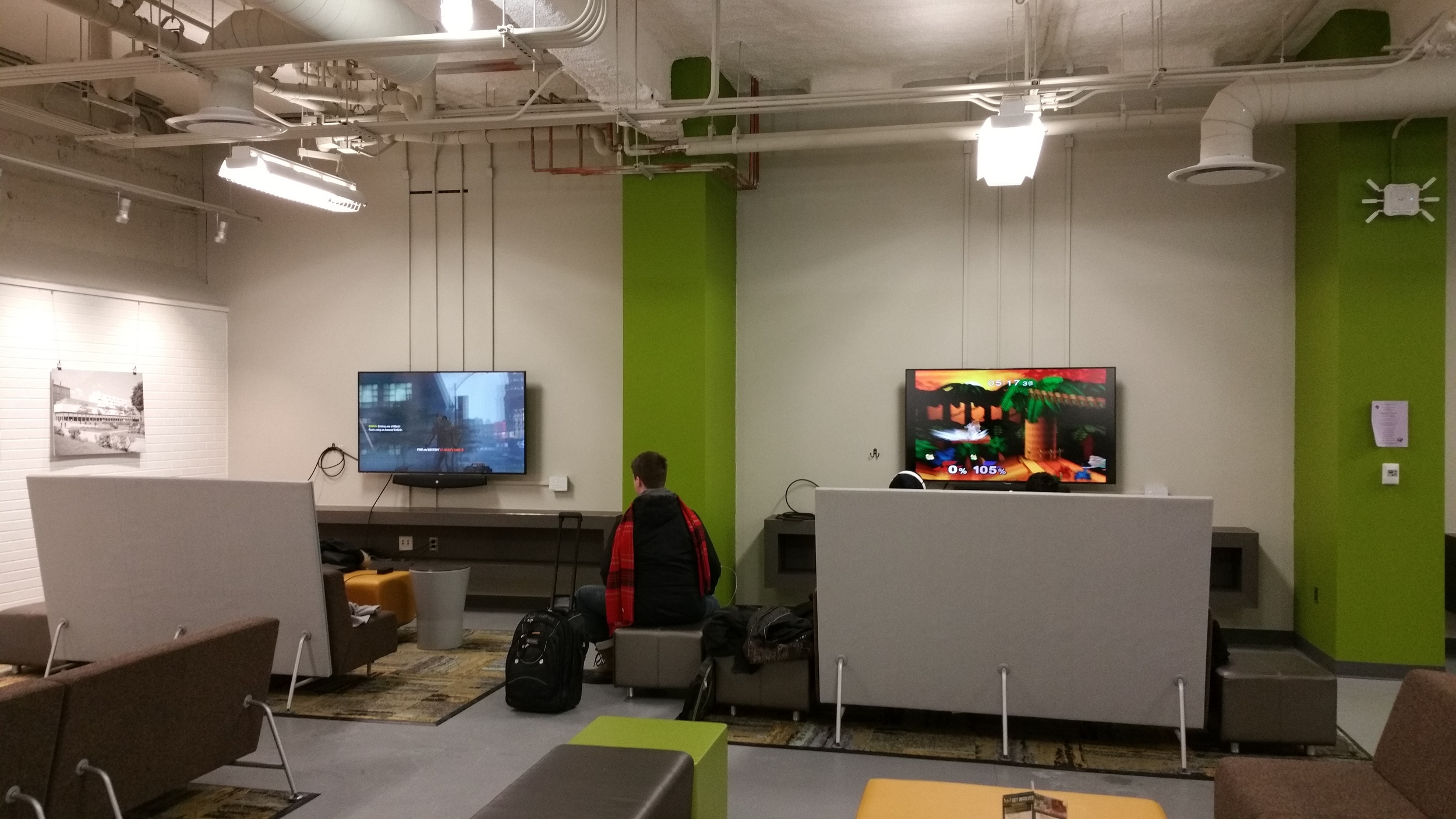 The Student Center at Wayne State University (my grad school) is  undergoing a $27 million renovation . One of the new additions is this gaming area with screens and cables, ready to connect to any gaming system or computer.