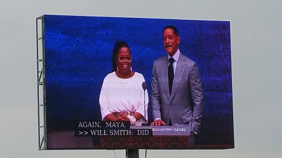 Oprah Winfrey and Will Smith present at the museum grand opening.