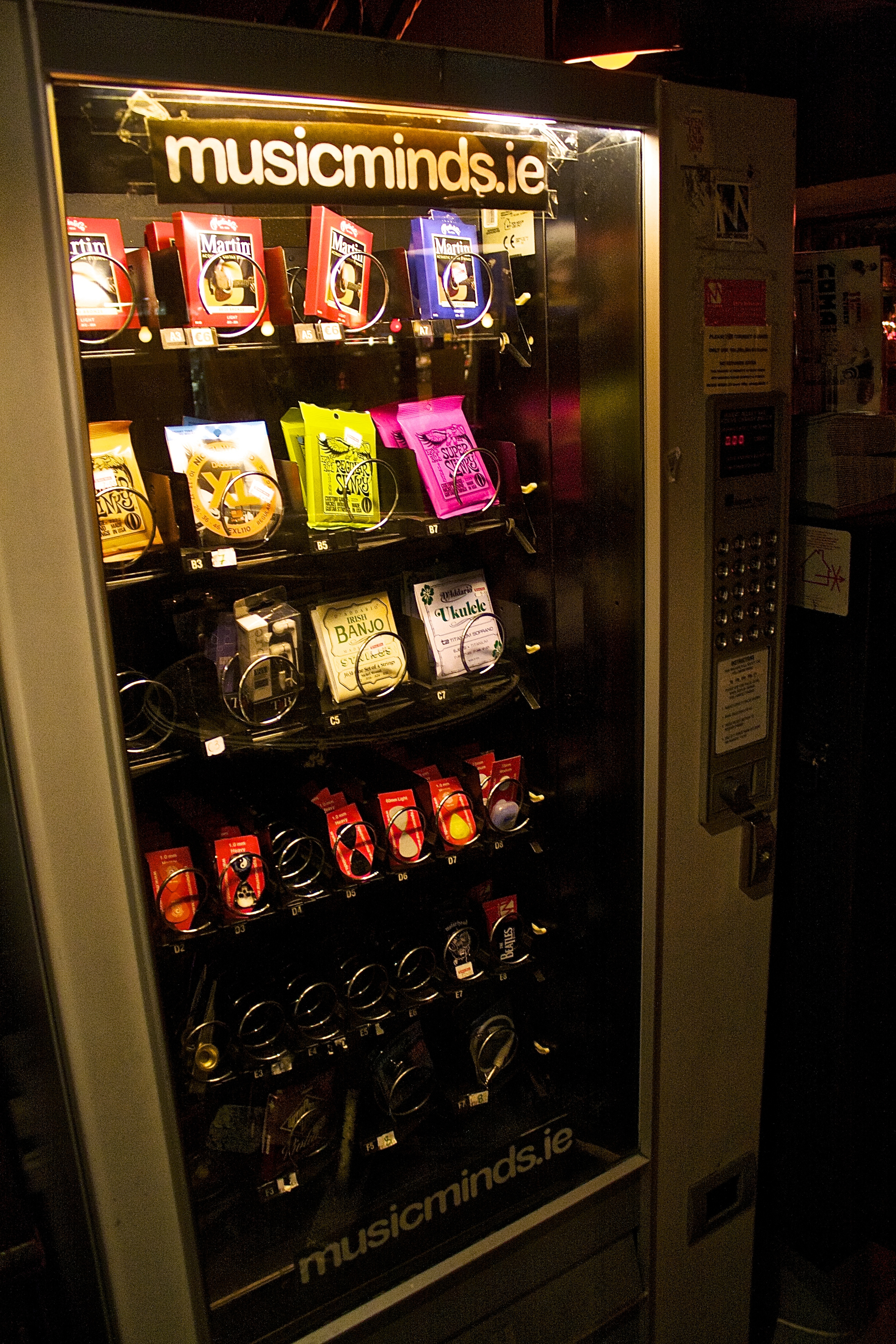 A vending machine to guitarists with plectrums, headphones, guitar strings and so on.