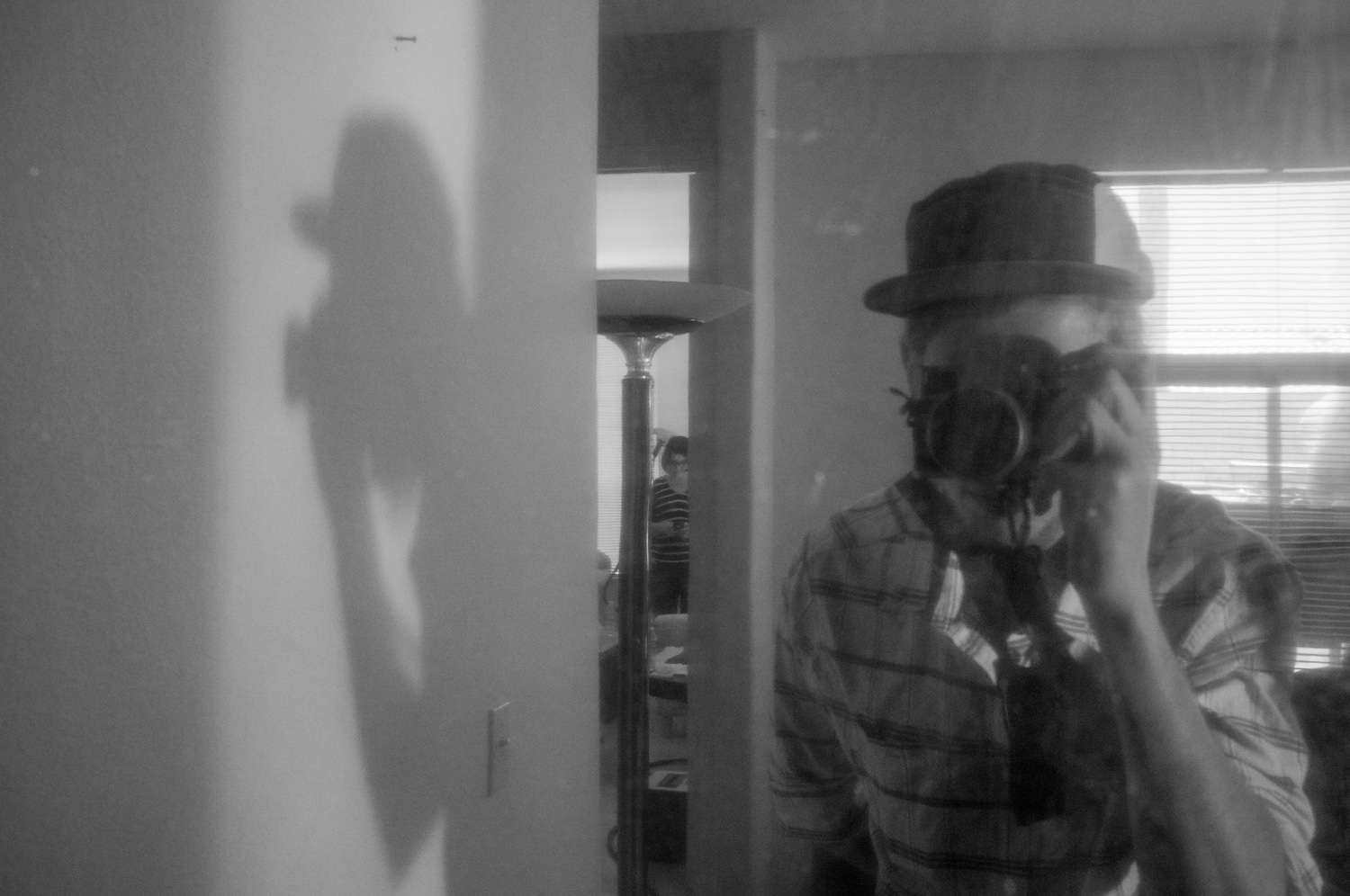 Just a shadow of a man. Got this completely by accident, as I was trying to shoot the ladies reflection