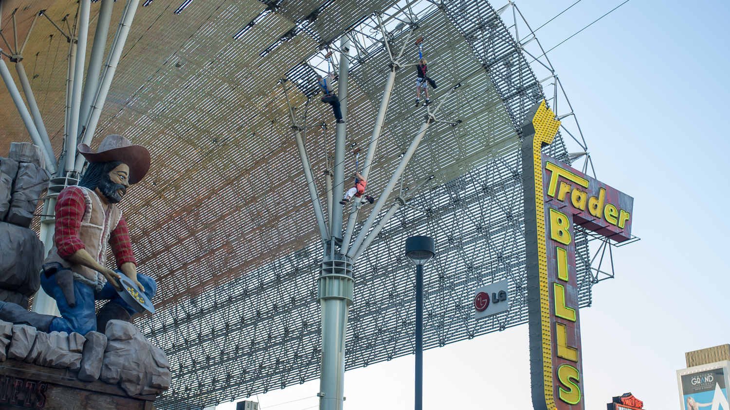 """Zipliners """"zipping"""" past. Can only imagine how cool it would look at night with the lights on."""