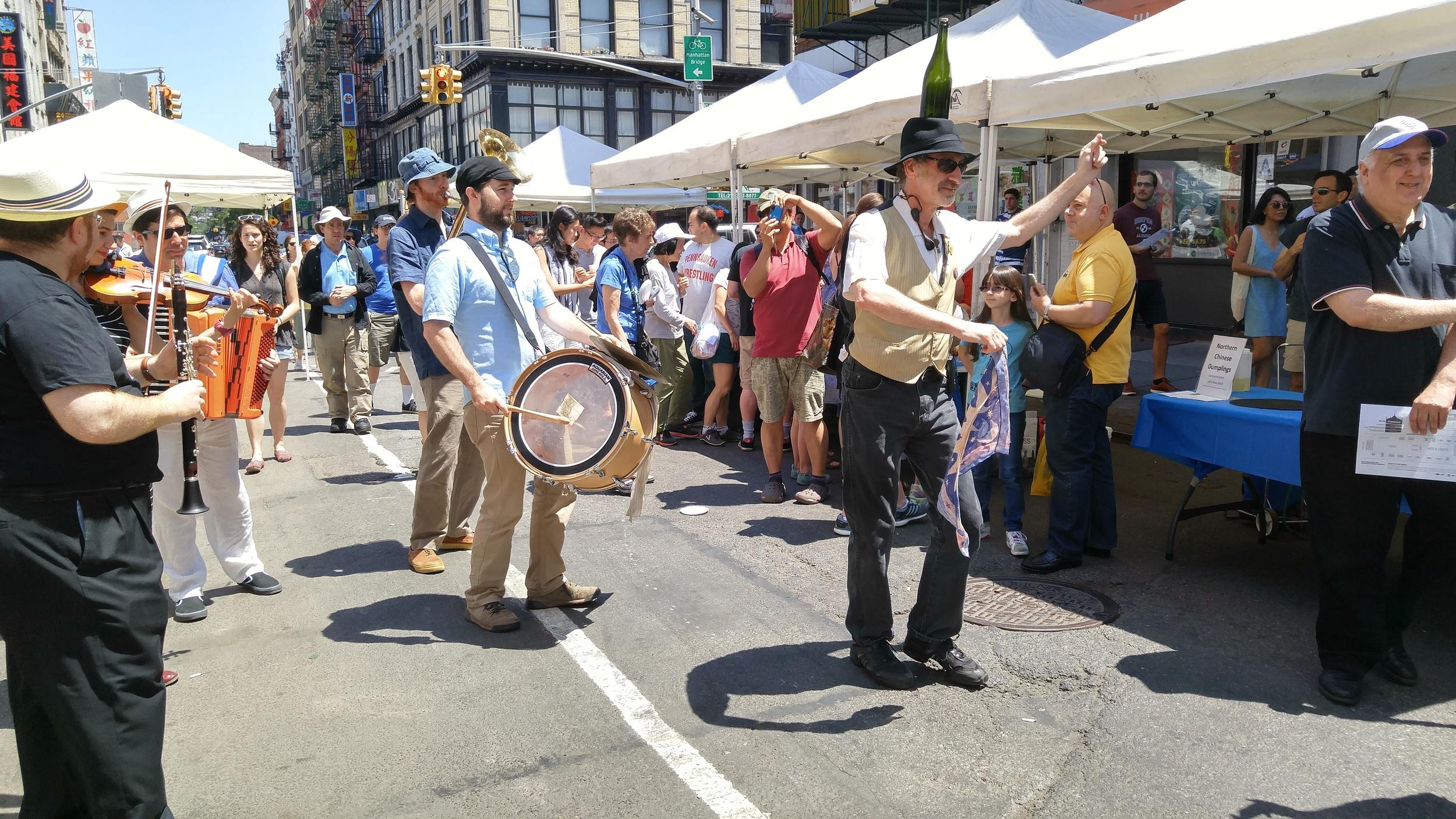 A Klezmer band parades down Eldridge Street.