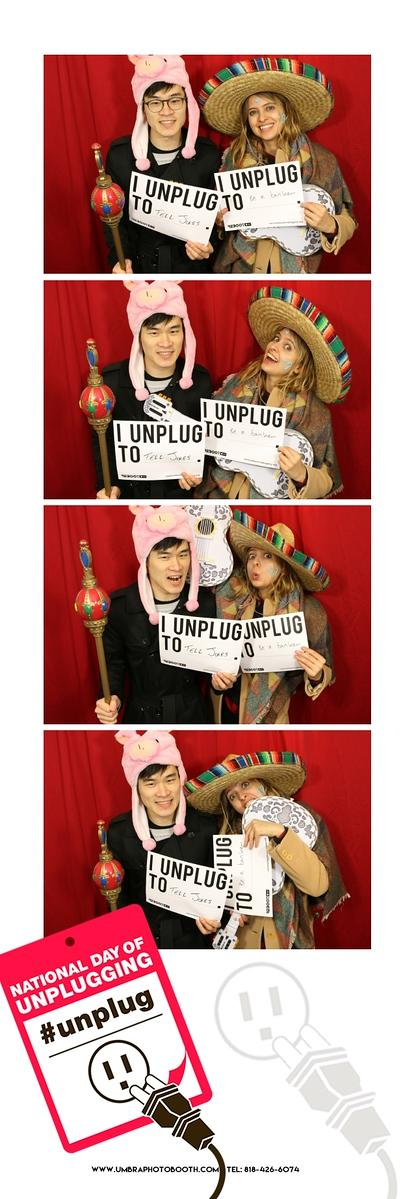 Two guests in the vintage-inspired photo booth at an NDU event.