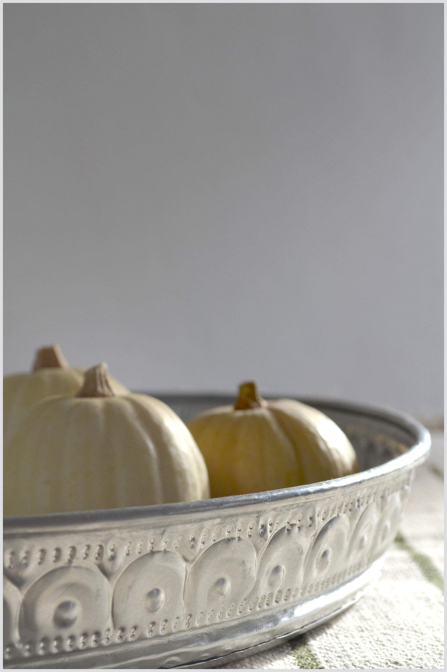 Silver tray and white mini pumpkins