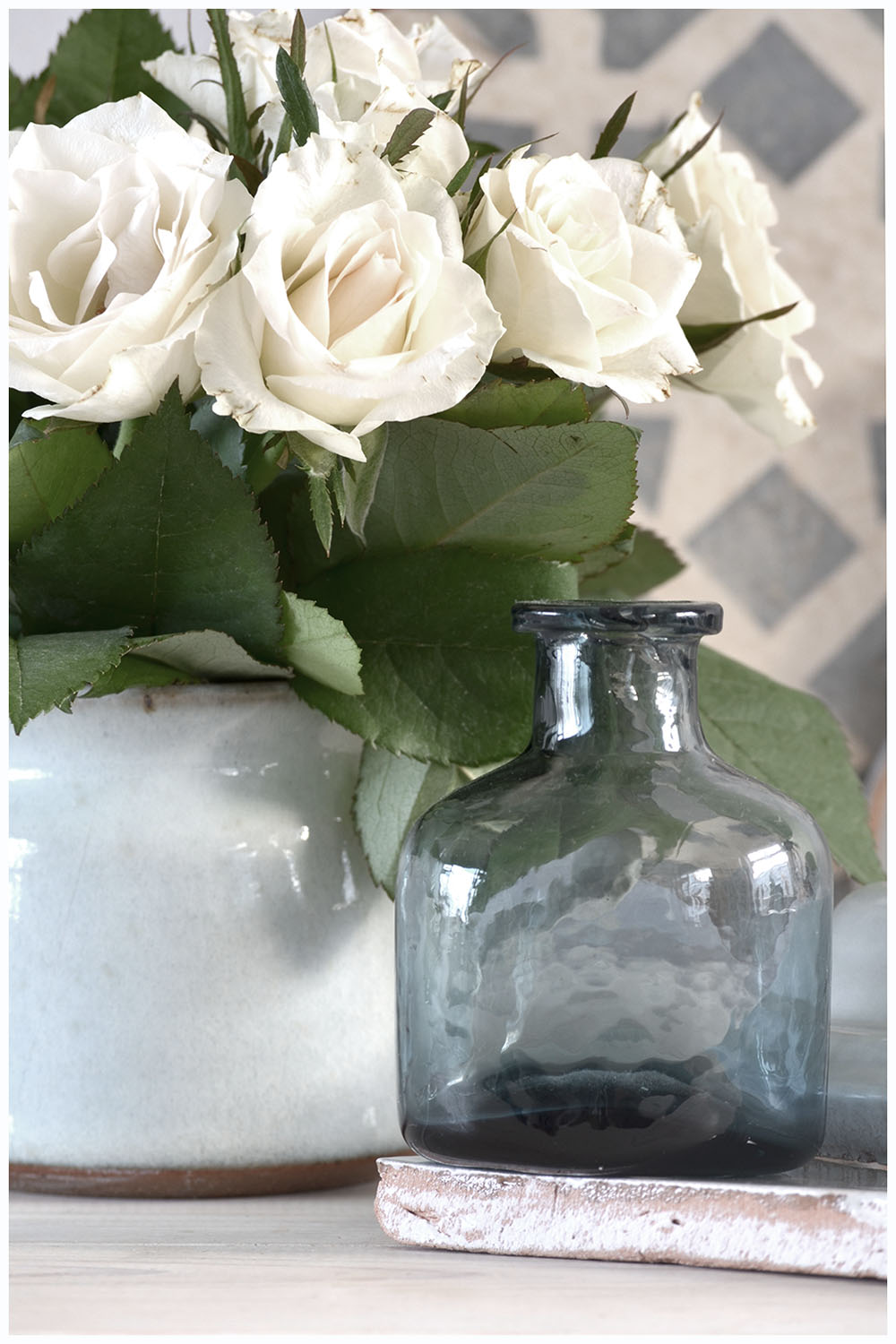 White roses, blue bottle, moroccan tile