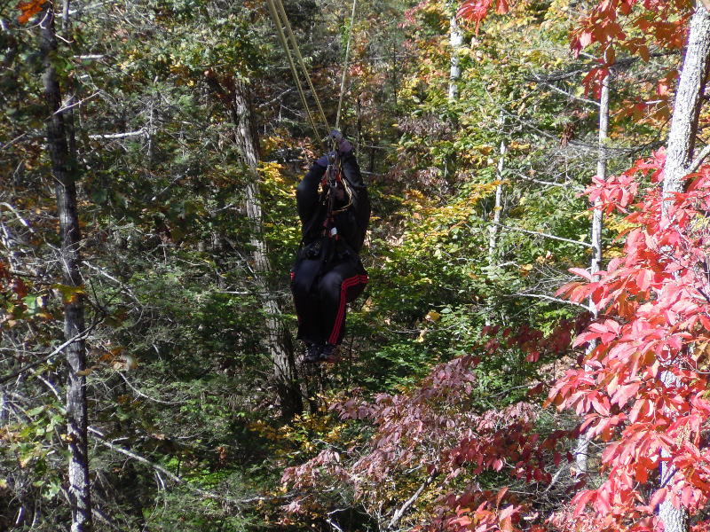 Shannon riding the zipline