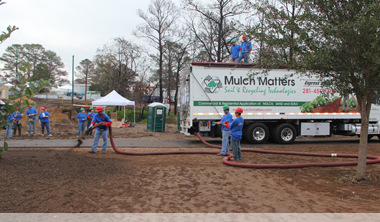 Image-1level-EHMO-guy-with-hose-and-truck.jpg