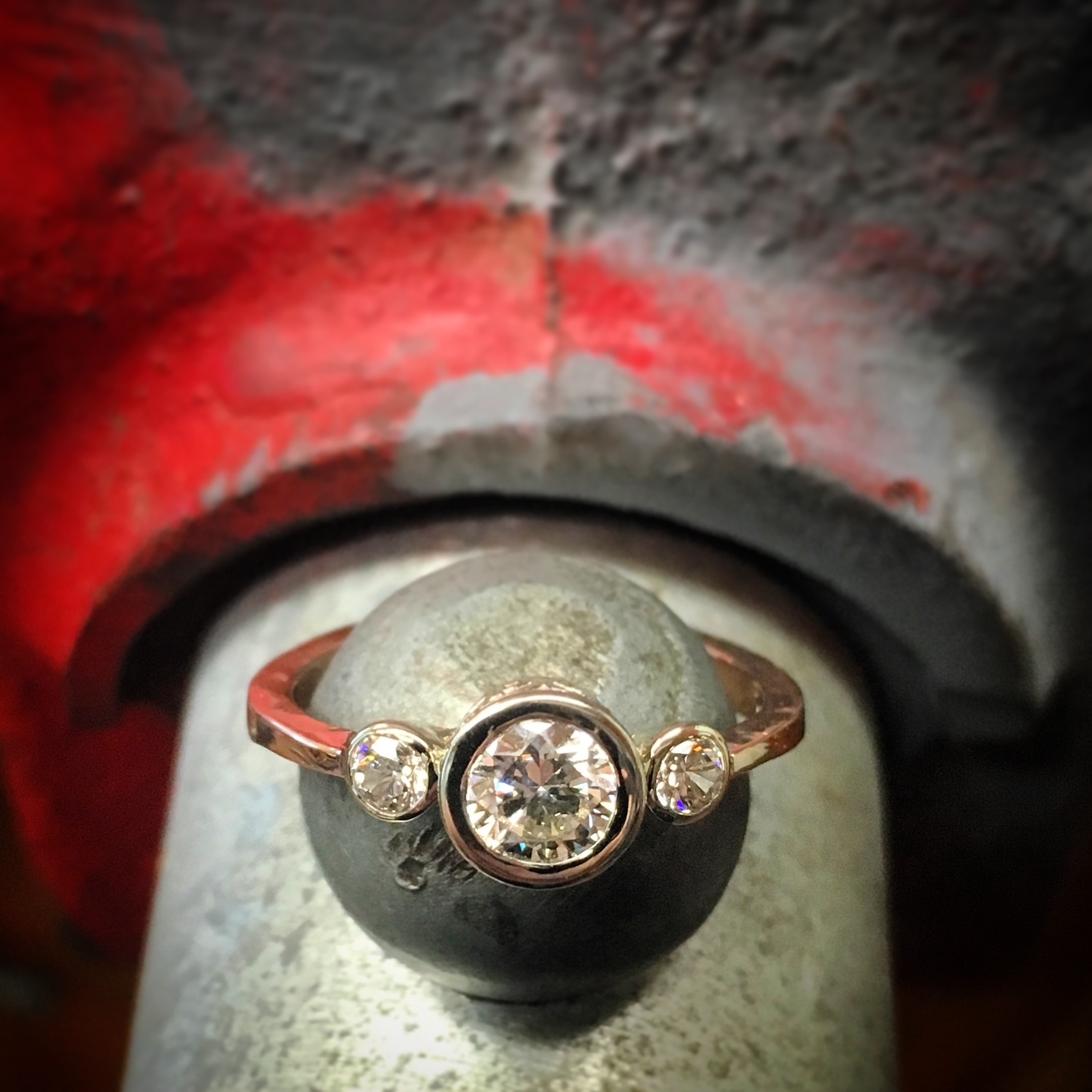 Forged rose gold with diamonds in white gold settings.