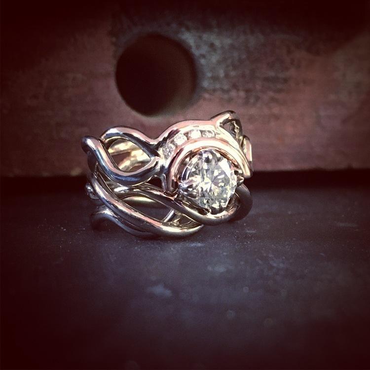White & Rose gold woven around diamonds.