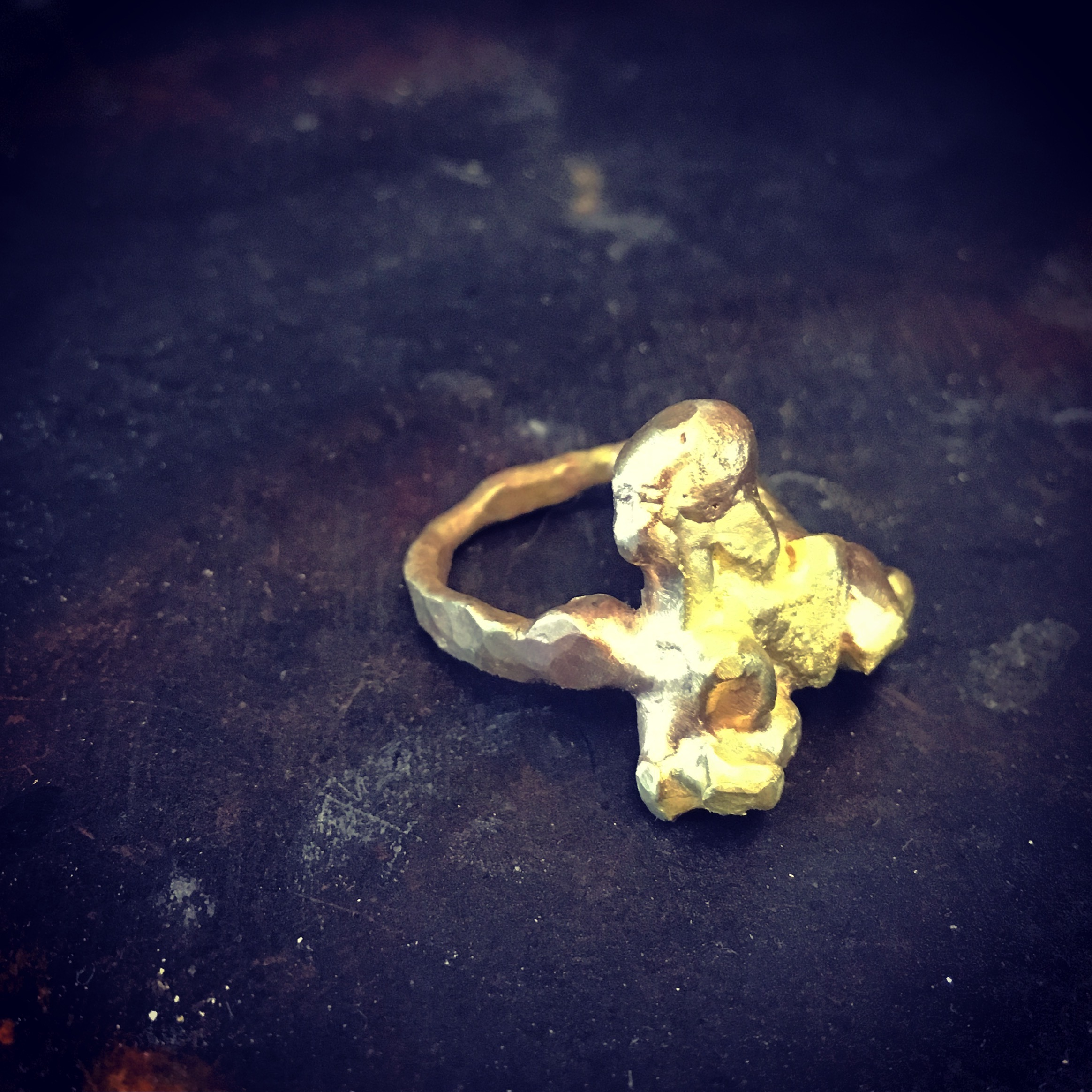 Gold from all three rings was forged into this raw ring.