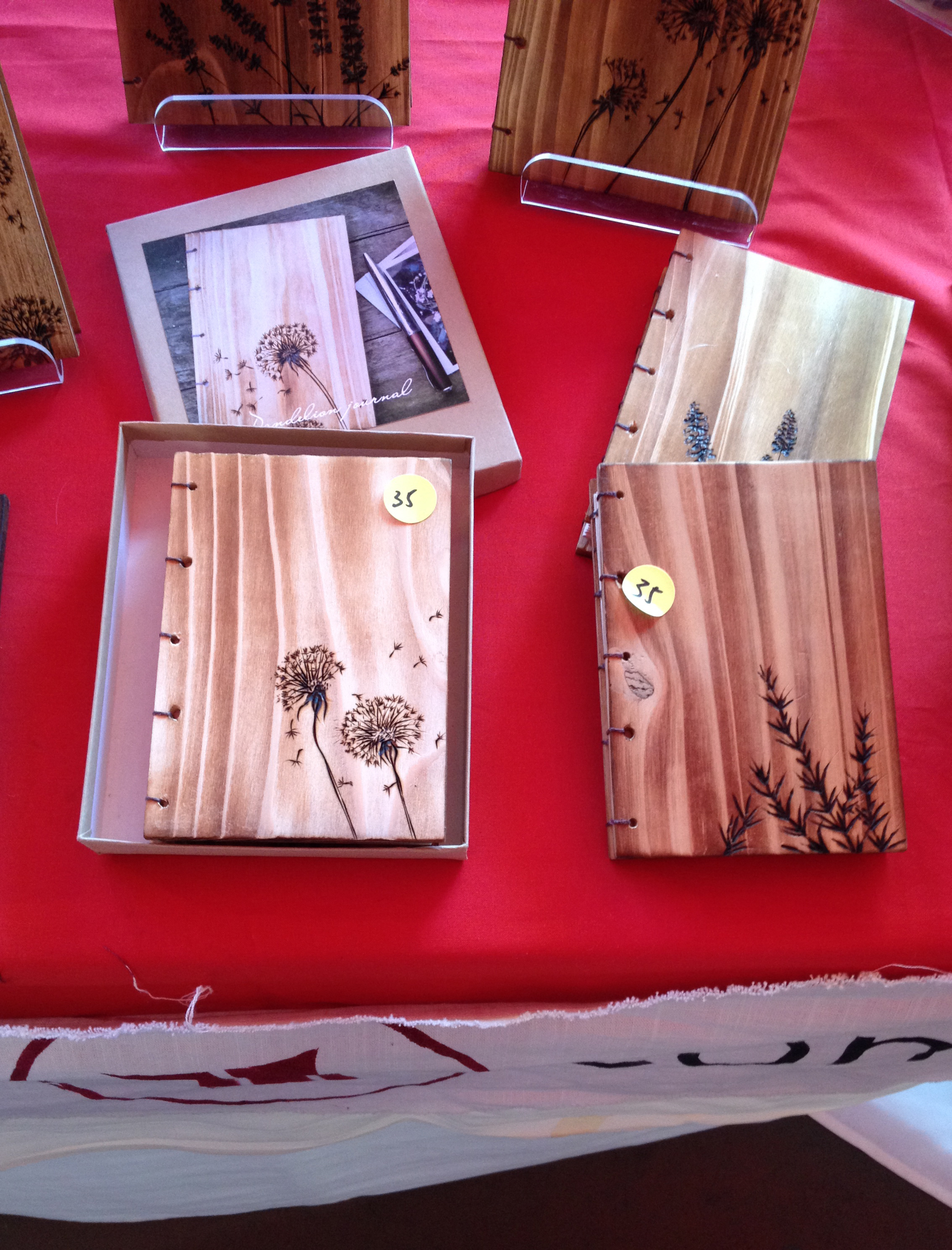 I fell in love with these handmade wood burned journals by  M-Squarepress . The maker was so sweet.
