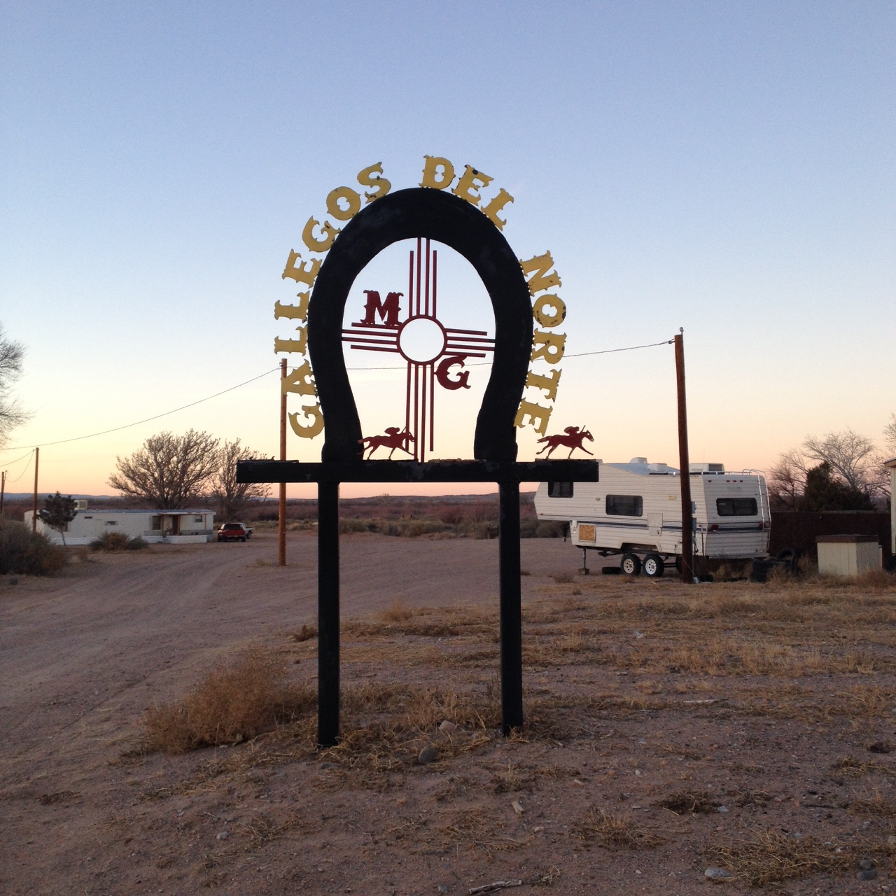 A neighboring ranch. I love the sign with the Zia symbol and horses.