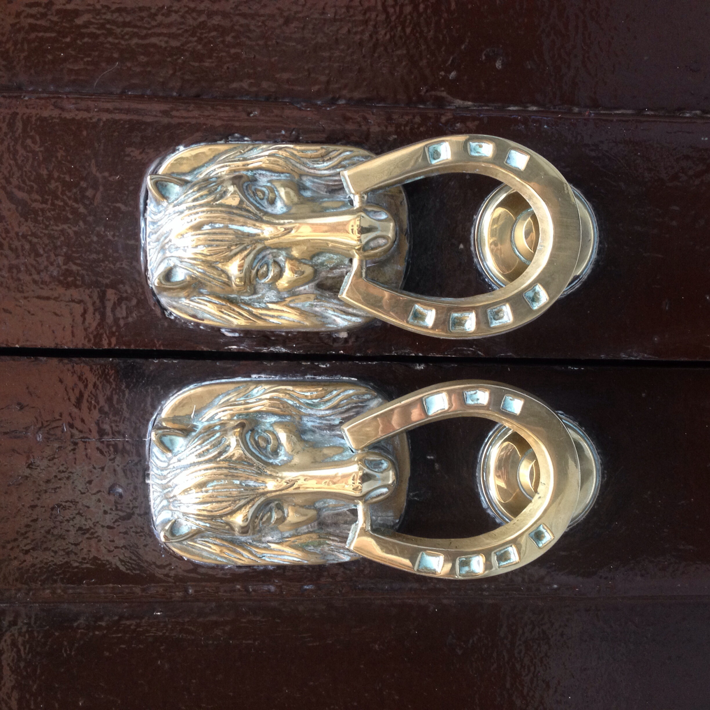 Horse door knockers.