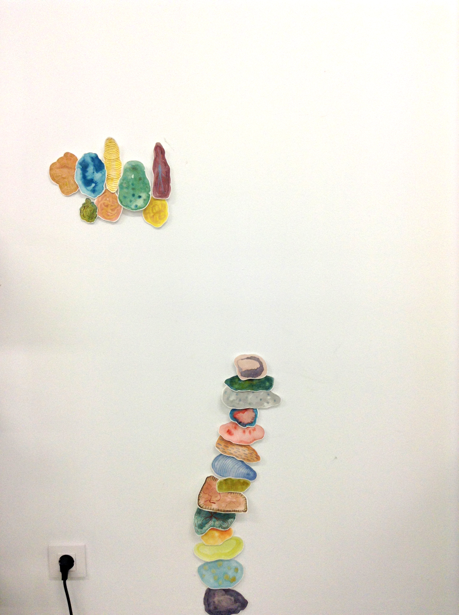 "Experimenting with ""gotas"" or blobs piled along the wall."