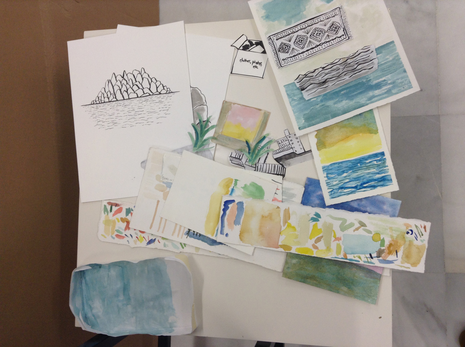 Paint test sheets, cut shapes, ink drawings and watercolor paintings.