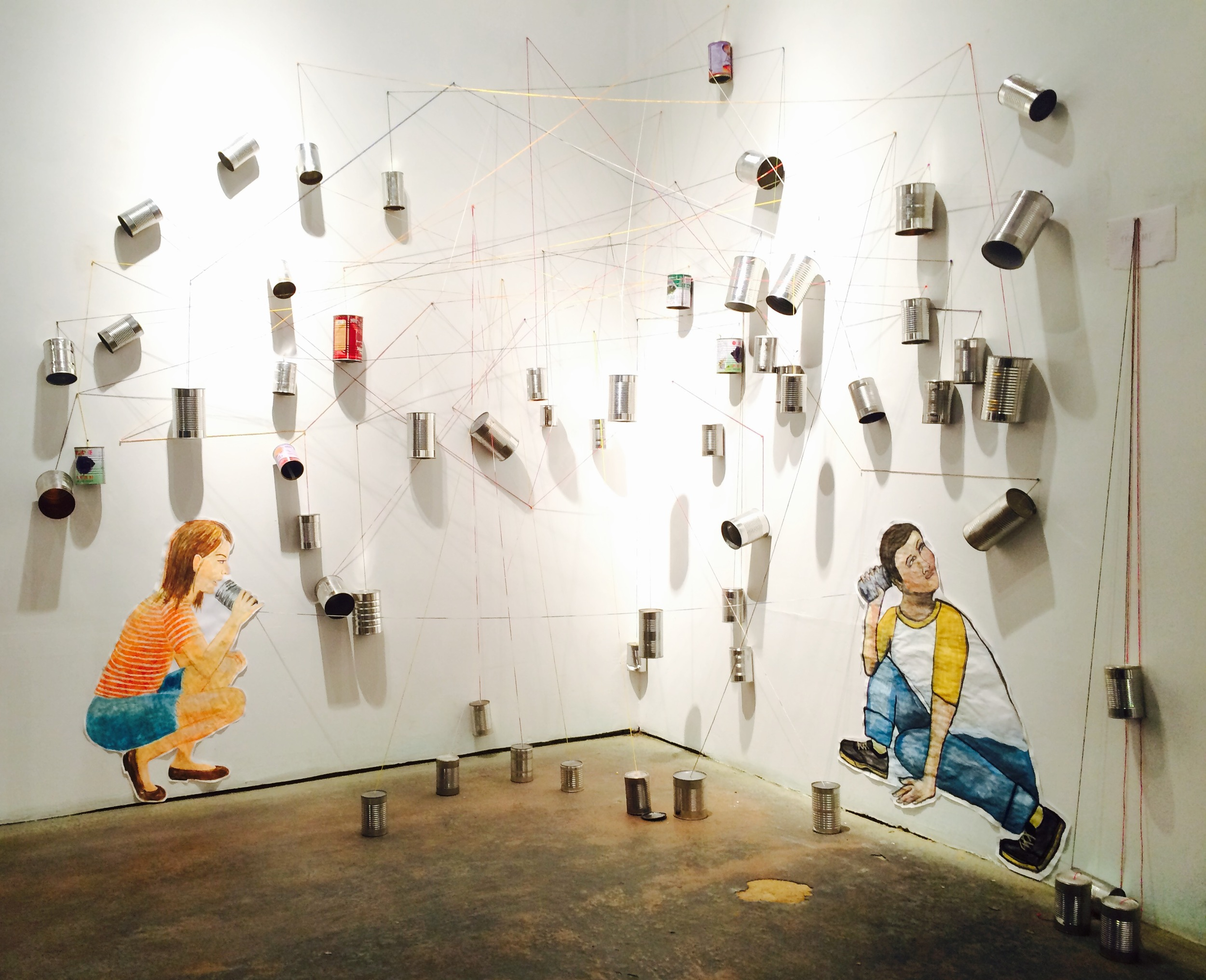 String Theory, art installation by Frances Marin and Anabella Pi ñ on at Citadel Gallery. Watercolor, paper, dyed string and cans.