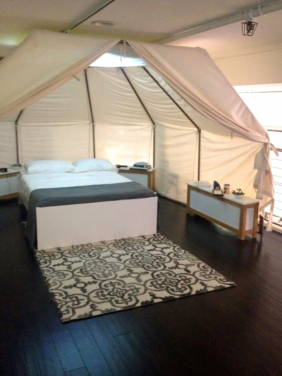 A Casper bed in a tented room.