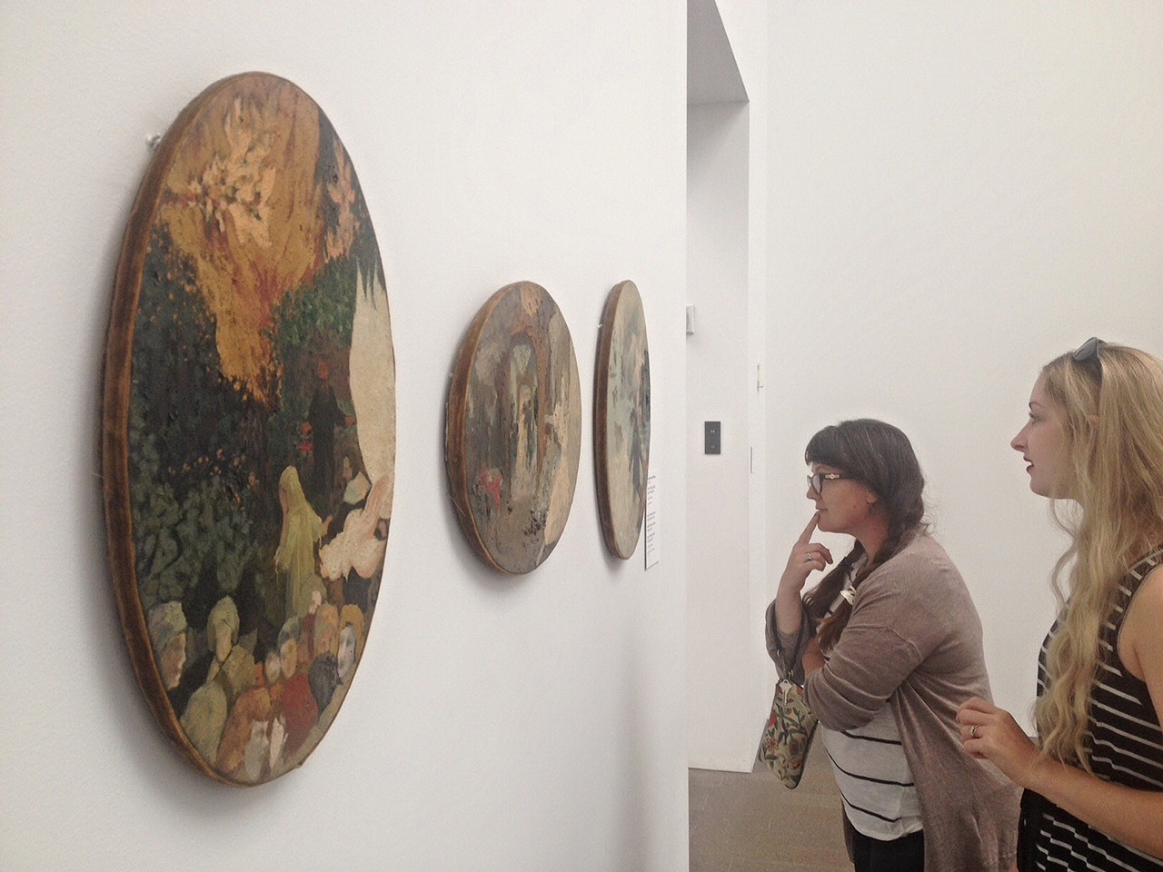 Elissa and Laura checking out the velvet bordered paintings