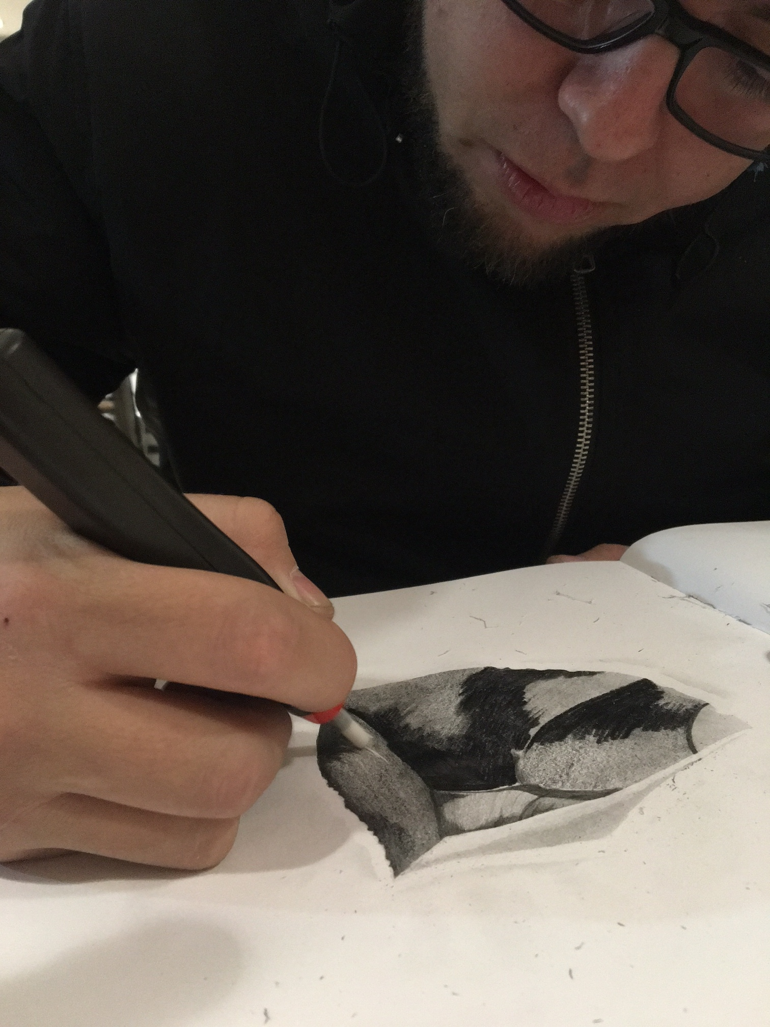 MIguel Machuca  sketching with a battery-operated eraser