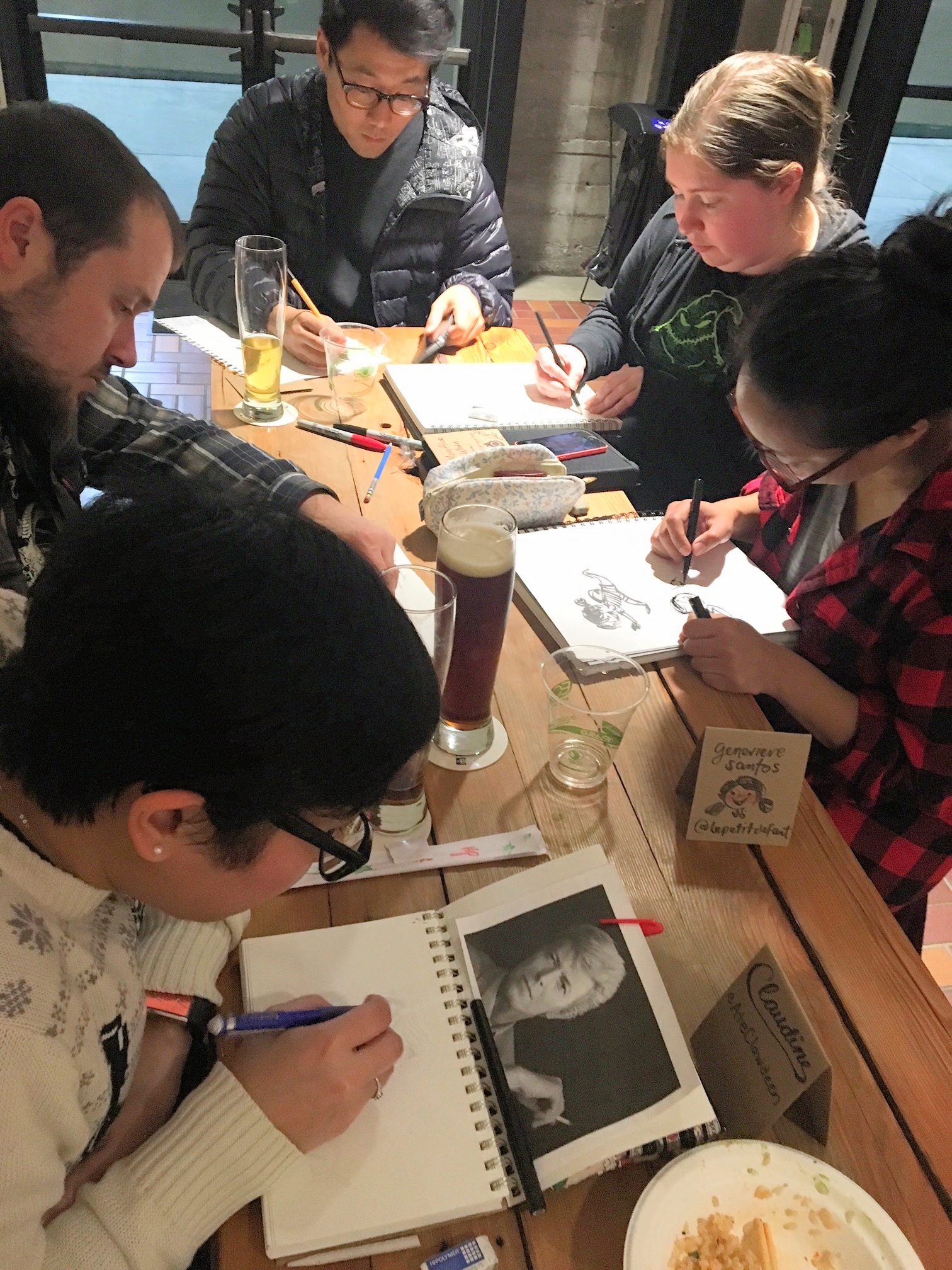 A table of artists sketching