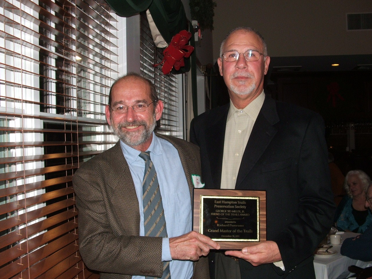President Jim Zajac presented the 2011 Friend of the Trails Award to Richard Poveromo, VP of Trails Maintenance, at the holiday party in December.