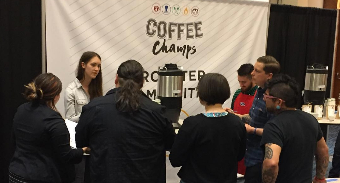 Crisitina, the roaster for our friend's at  Deeper Roots Coffee,  competing with her version of the Kenya coffee. (John recused himself from this round of judging.)