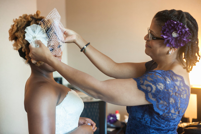 There is nothing like a mothers love. Alyssa's mother putting the finishing touches on this stunning bride.