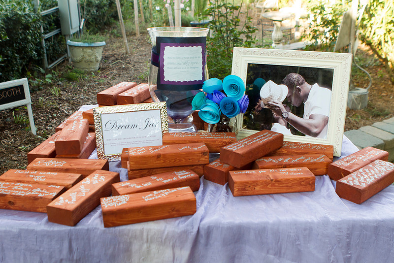 No normal guest book for guest to sign, instead guest signed oversized Jenga blocks. Now every time Alyssa and Reggie play this game, they are always reminded of the kind words from their friends and family.
