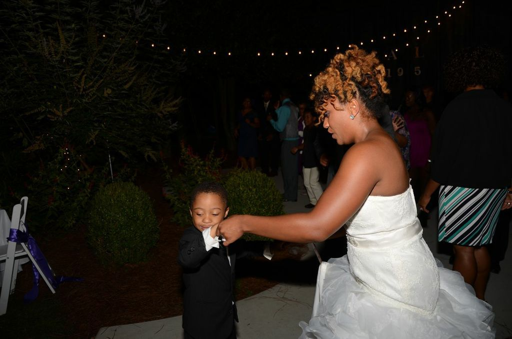 The brides little cousin who I overheard saying, he was suppose to marry Alyssa!  Too precious!