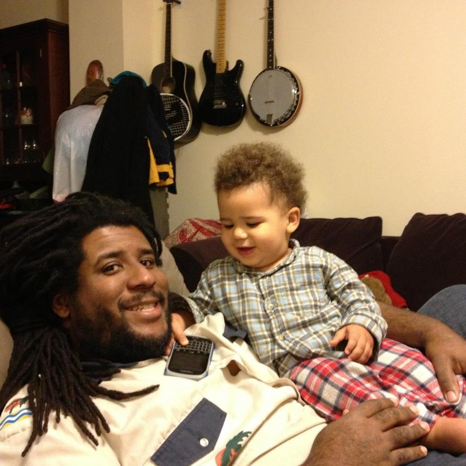 John at home in Baltimore with his son.