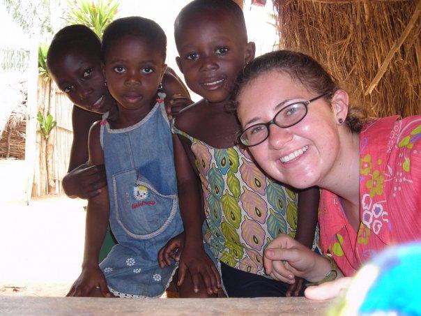 Anne with children in her village.