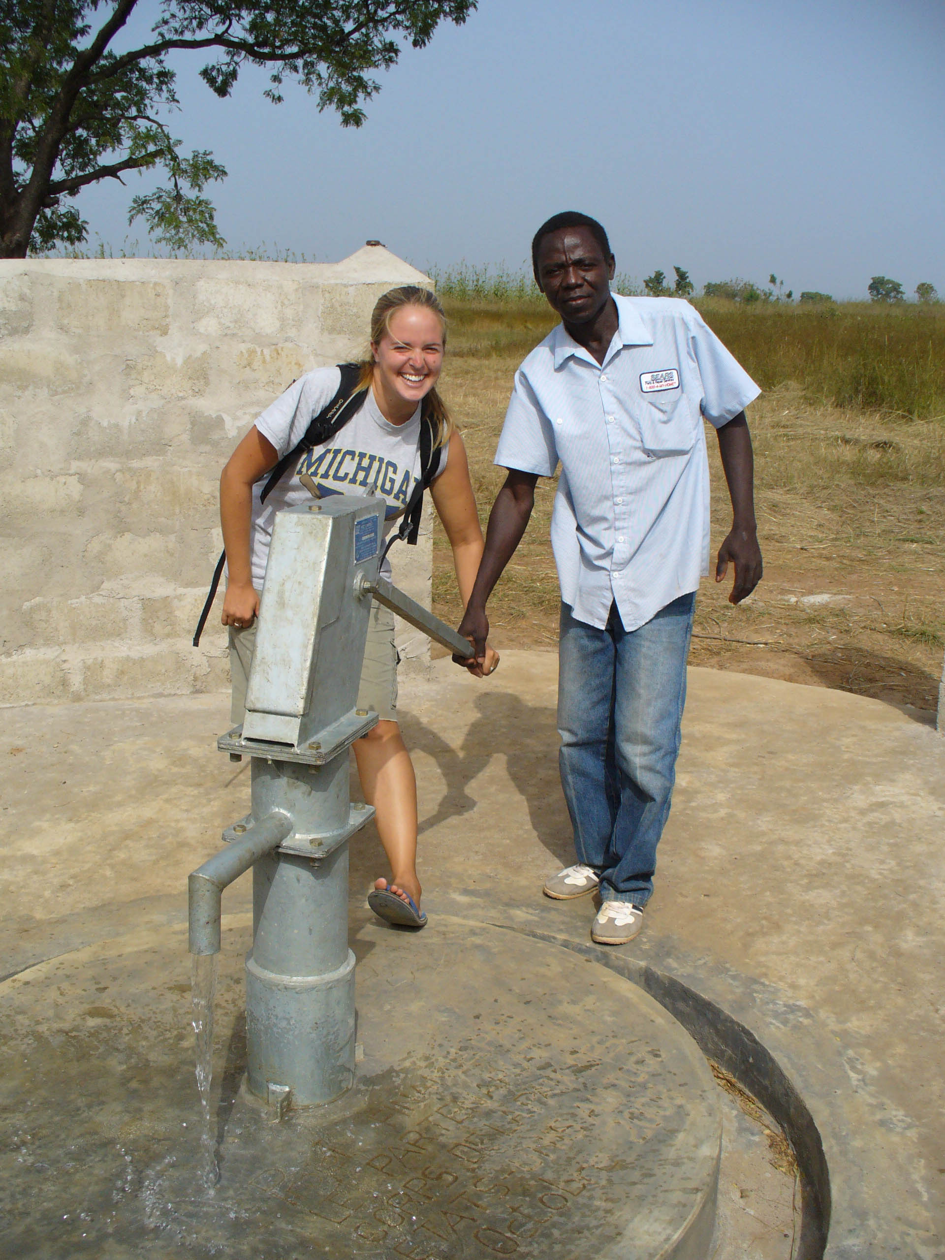 Posing with one of her water pumps.