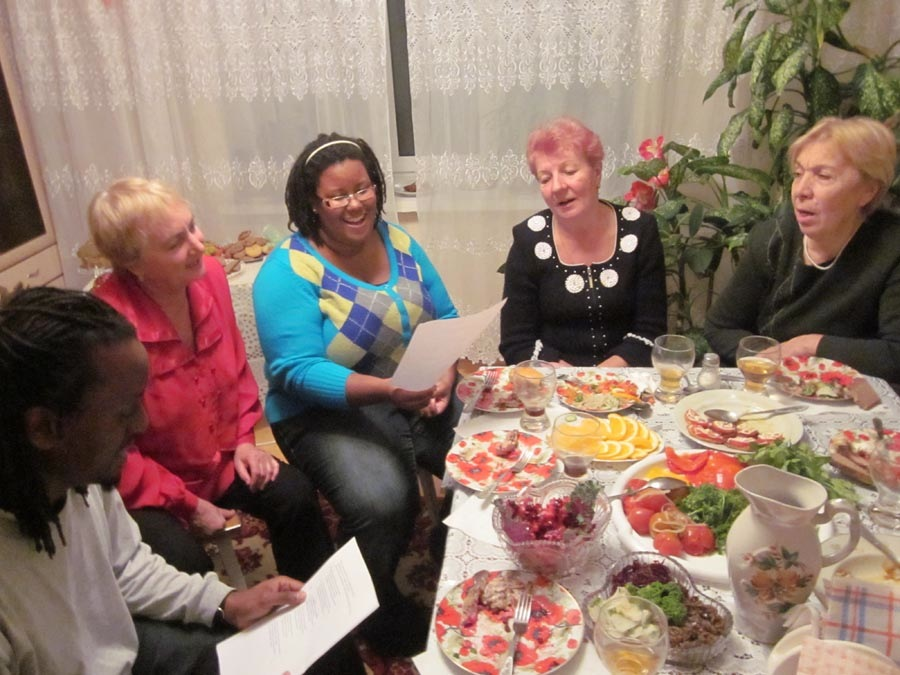 Thanksgiving dinner with host mother, Halyna (in red), and her friends.