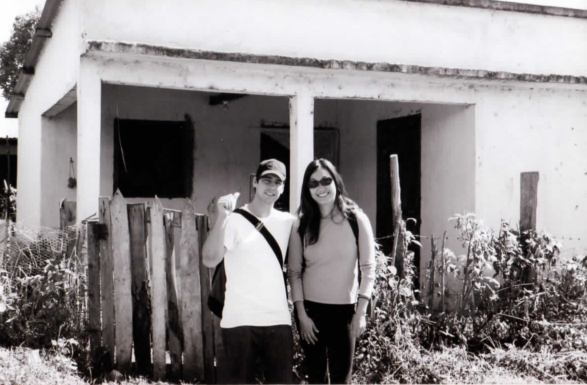 David and Jee in front of David's house in Guatemala.