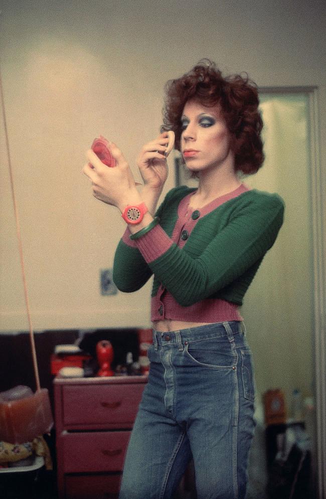 Nan Goldin  |     Kenny Putting On Makeup   ,  1973