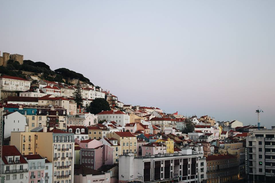 Enjoy your favourite cocktail as the sun sets with this view at TOPO Teracco in Lisbon.