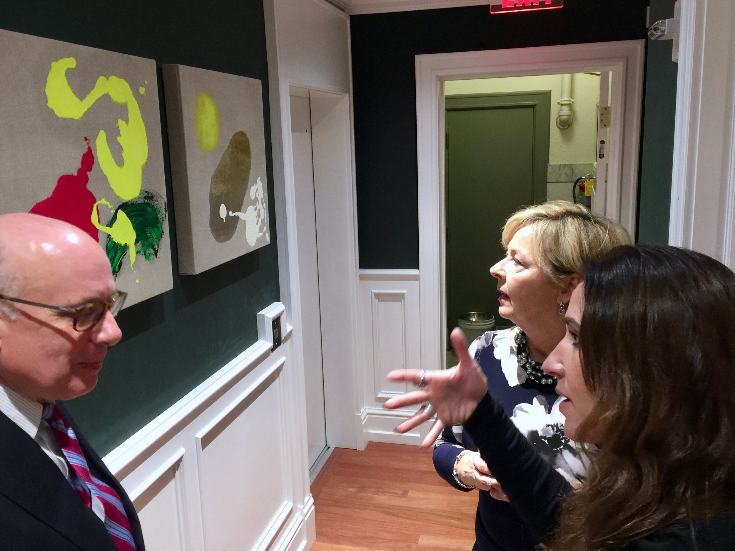 Mia Tarducci connects with guests over paintings.