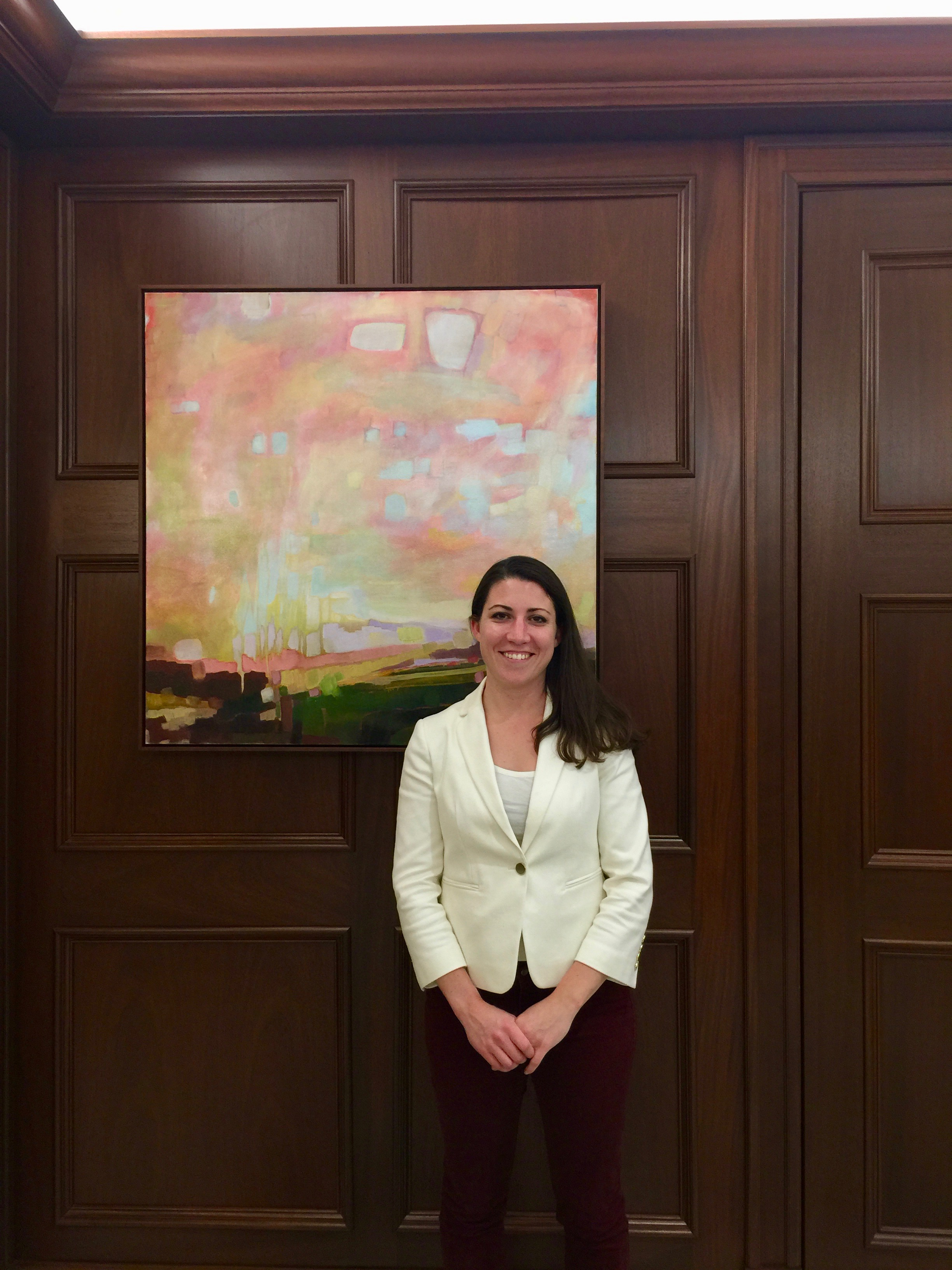 Nicole Ryan with one of her many oil paintings now in the Benter Collection.