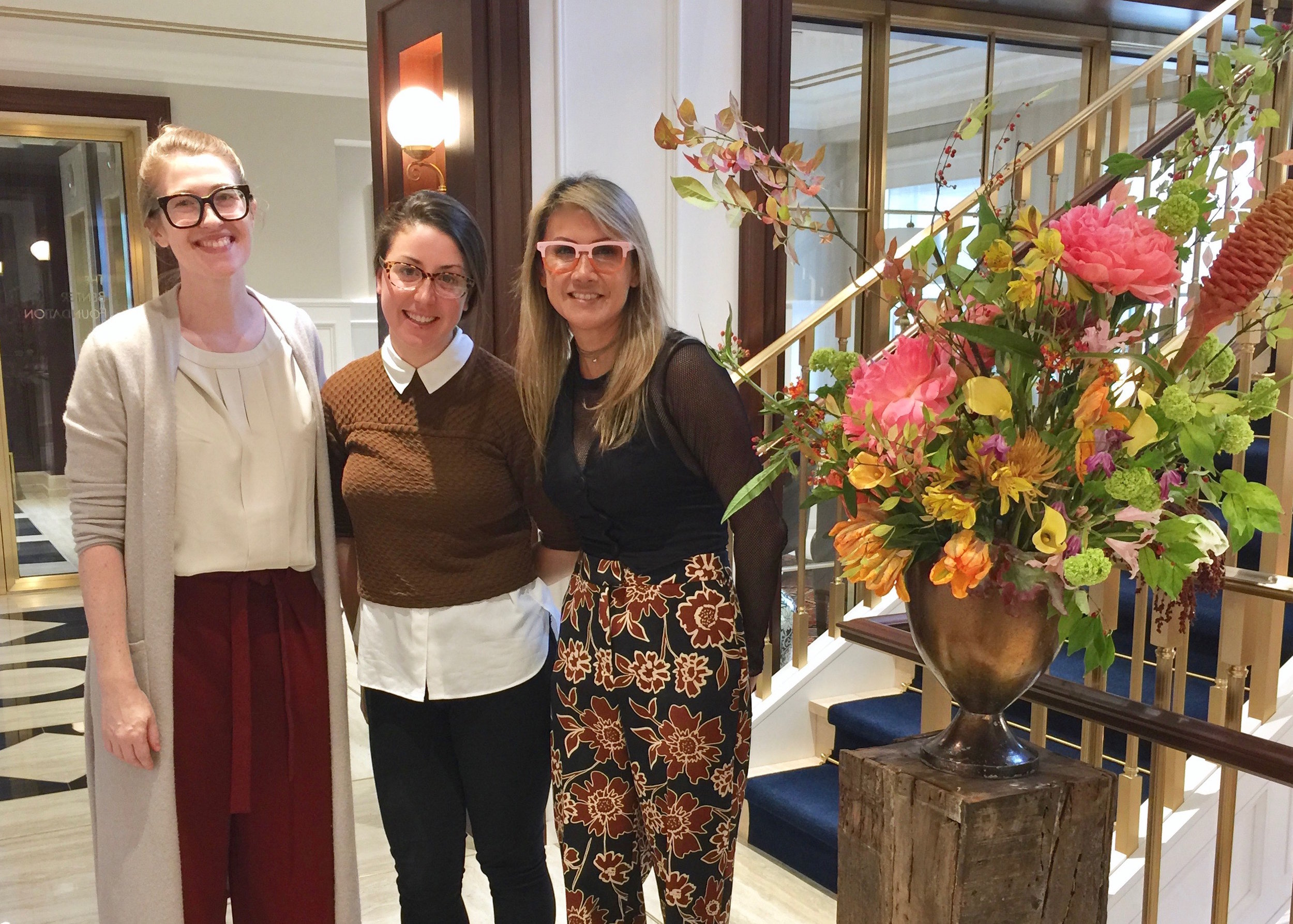 The CDCP Team: Casey Droege, Leah Mackin, and Johanna Lasner, with special guest team member, a lovely floral arrangement!