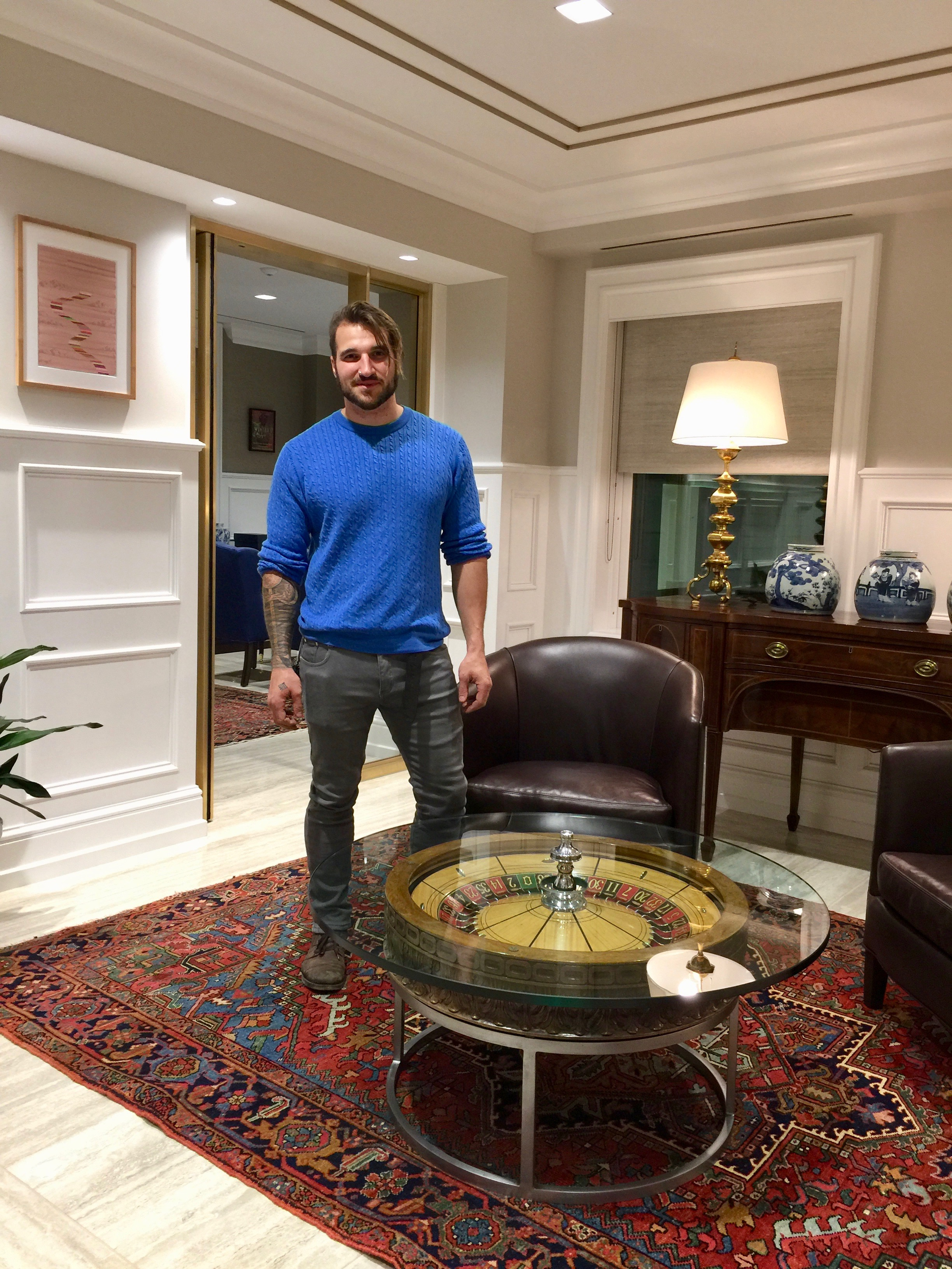 Artist, Nicholas Volpe, with his custom-crafted table made from an artifact from Bill's personal collection.