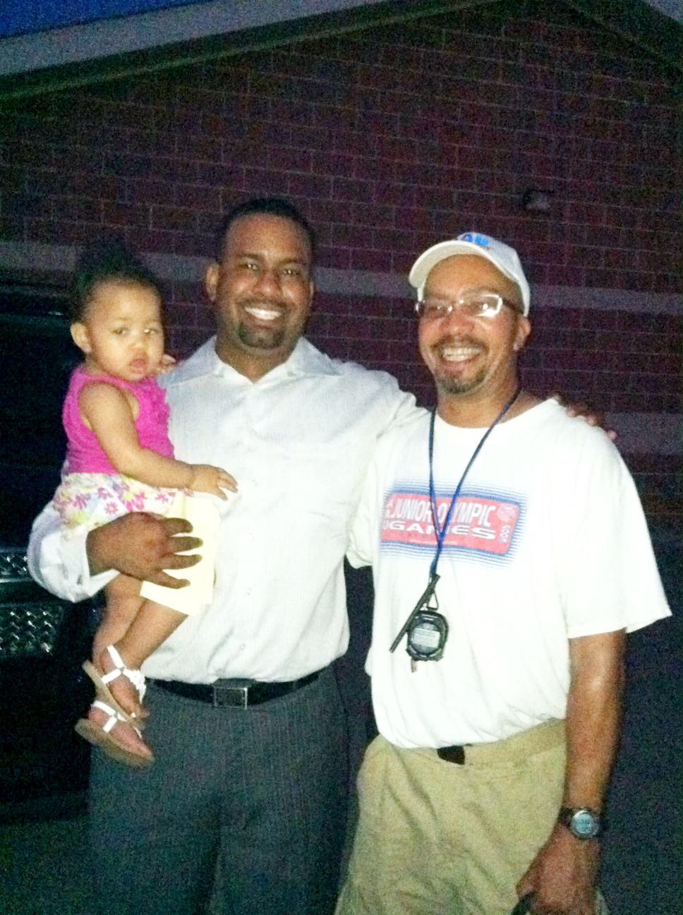 Coach Johnson & Coach Akiva with daughter.jpg
