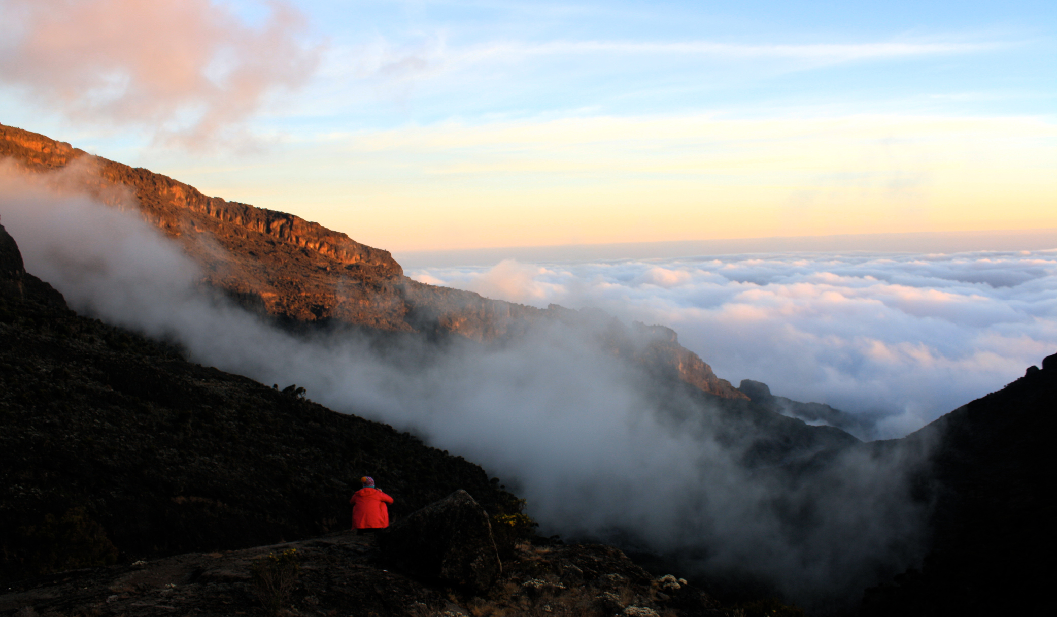 Me enjoying the sunset from above the clouds at barranco camp on Mt. Kilimanjaro.