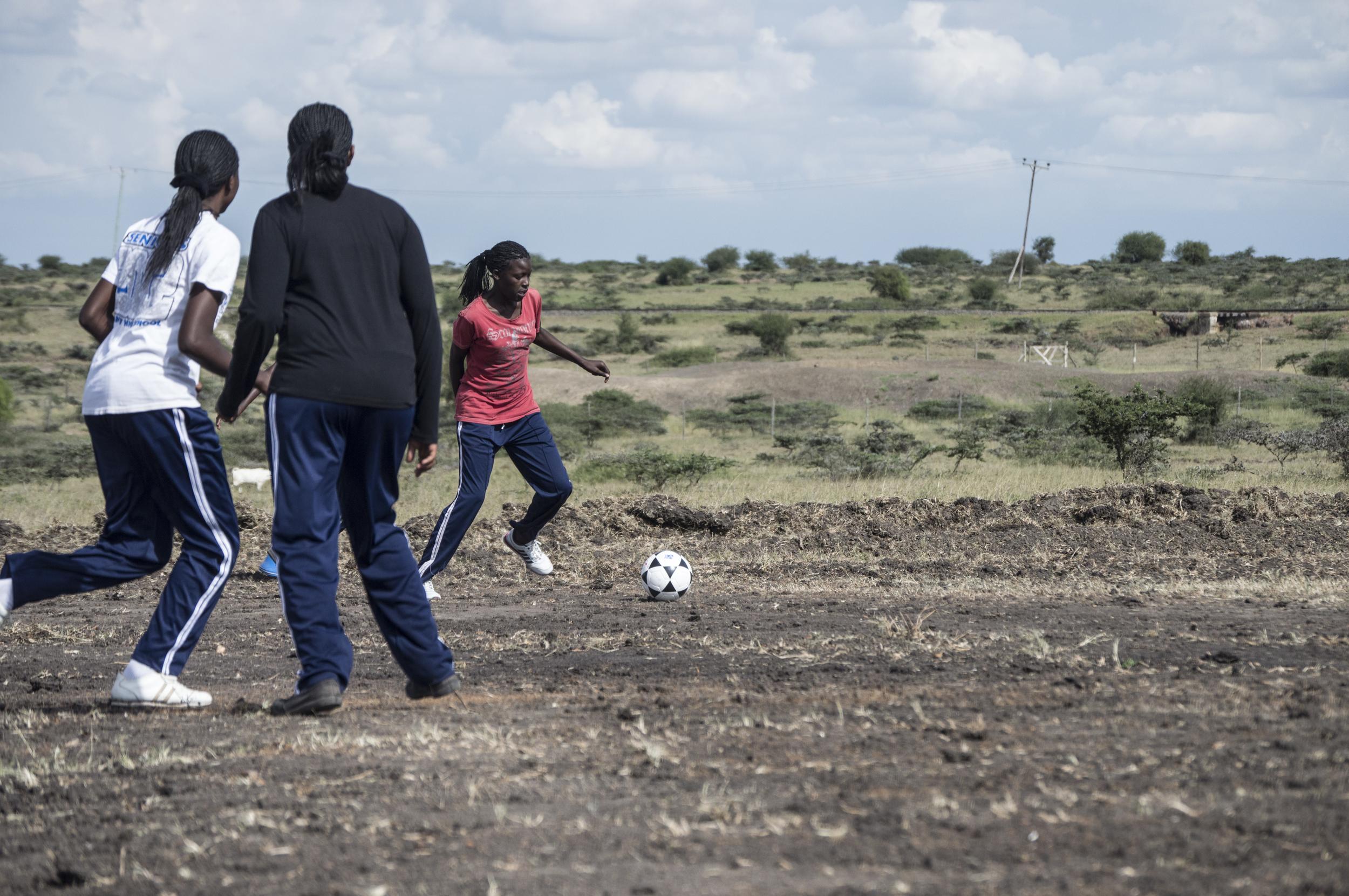 Tebea soccer trio.jpg