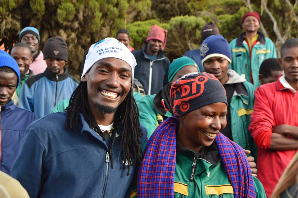 William, our lead Kilimanjaro guide, smiling with our awesome female porter!