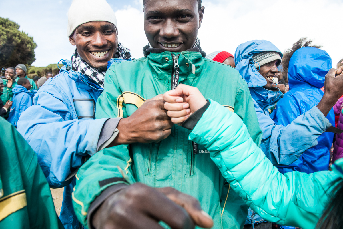 "Experience the Undugu - This word means brotherhood and it encompasses the attitudes of Tanzanians. Broadly, it means extended family, generosity and compassion towards everyone in the community. Tanzanians go out of their way to help anyone who may need it...so say ""Jambo! Mambo!"" to all the dada and kaka you encounter on the mountain."